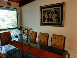 Picture of the Three Graces hanging above the dining table